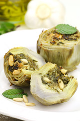 Artichoke hearts stuffed with herbs, parmesan and pine nuts