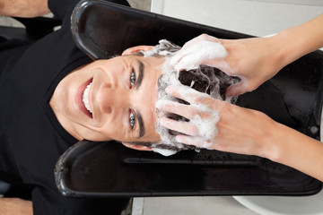 Client Getting Hair Washed At Salon