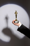 Oscar award in hand