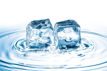 ice cubes falling on water surface