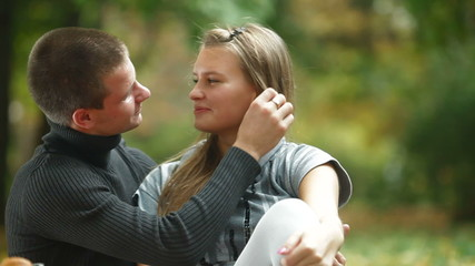 Teen couple in autumn park