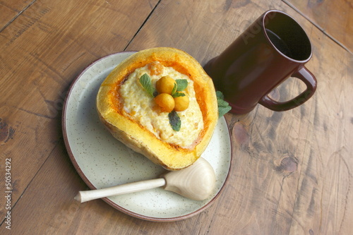 Russian fasting dish - pumpkin with porridge and a cup of kvass