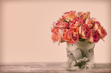 A bouquet of vintage roses decorated by old fabric
