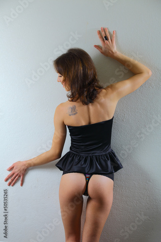 sexy woman wearing a corset backwards
