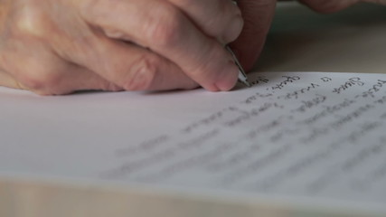 hand of old woman writing letter