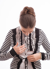 woman buttoning her blouse