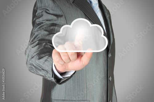 Businessman pushes virtual cloud button