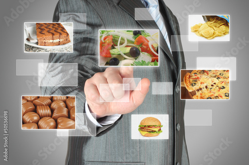 Businessman pushes touch screen button with salad Diet concept.