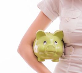 A woman with a piggy bank