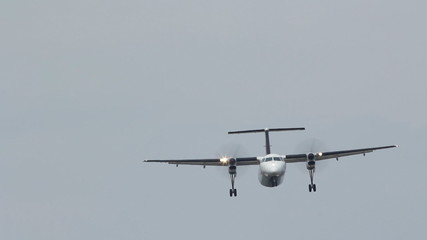 Approcach of Bombardier Q400 turboprop aircraft.