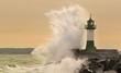 Leinwandbild Motiv Leuchtturm im Sturm
