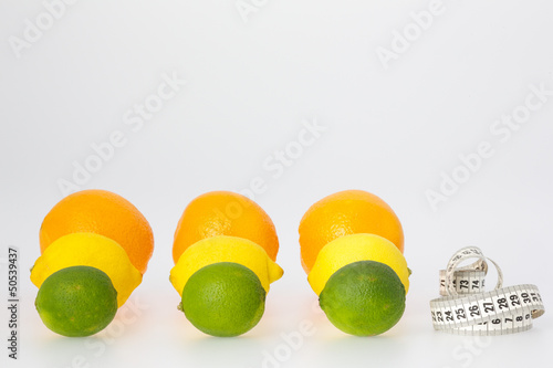 Citrus Fruits and Measuring Tape
