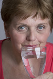 old woman drinking mineral water