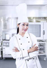 Beautiful chef on kitchen