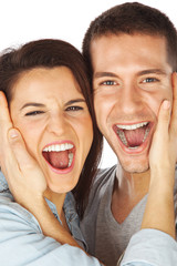 Closeup of happy young couple screaming