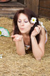 Loves me, loves me not. girl tells fortunes on a flower camomile