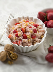 risotto with strawberries and nuts, selective focus