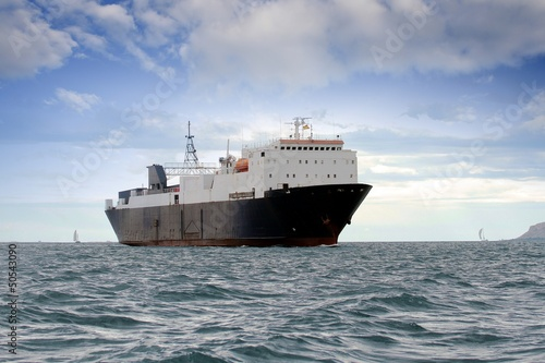 Cargo ship sailing close to coast
