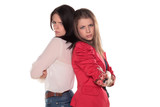 two scowling girl friends or sisters pose with arms crossed poster