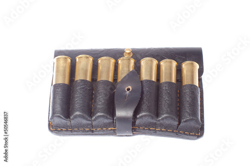hunting cartridges in black leather potrantashe on a white backg