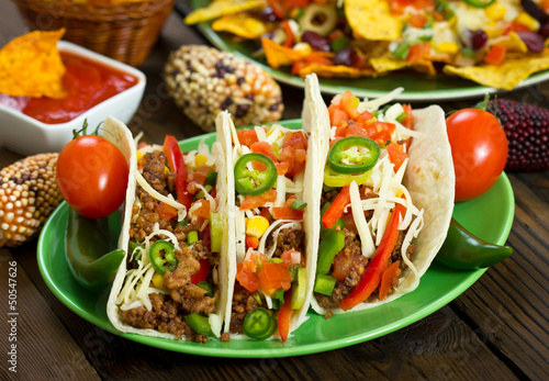 Beef taco on the plate with vegetables