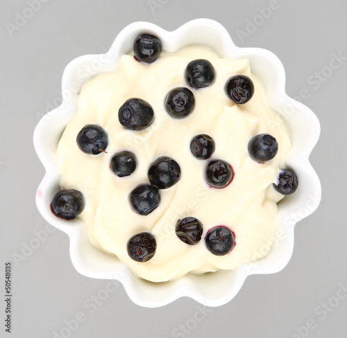 blueberries cream in a white bowl
