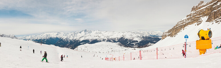Panorama of wintersport snow mountian landscape with ski tourist