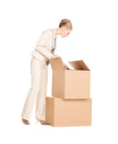 businesswoman unpacking big boxes
