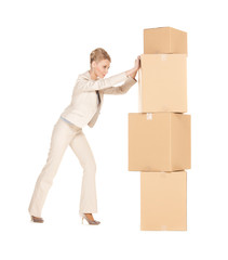 businesswoman moving big boxes