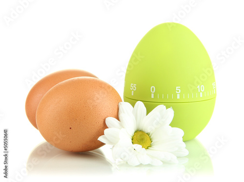 Green egg timer and eggs, isolated on white