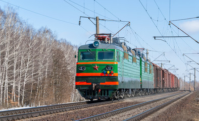 Freight train hauled by electric locomotive. Ukraine