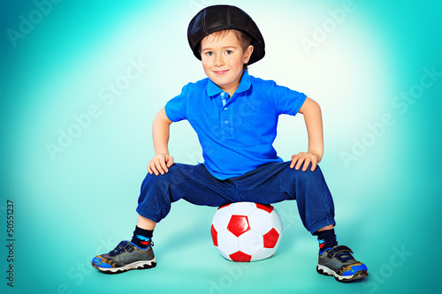 little  player  sitting with his ball.