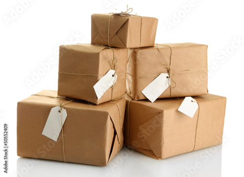 parcels boxes with kraft paper, isolated on white