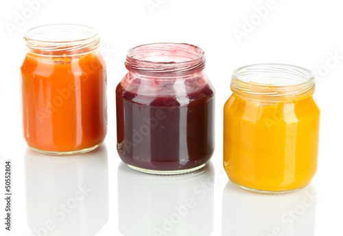 Baby puree in jars isolated on white