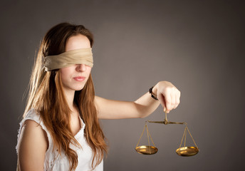 woman holding a justice scale