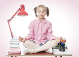 Schoolgirl meditating on the desk