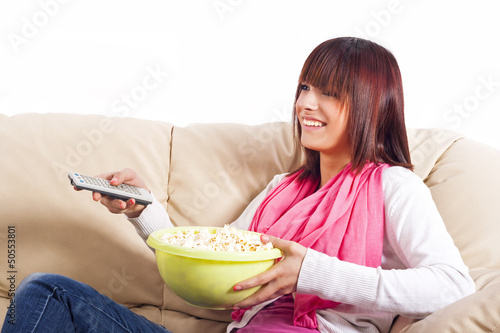 beautiful teenager watching television