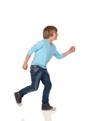 Profile of adorable preteen boy walking
