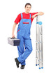 Full length portrait of a worker holding a tool box and leaning