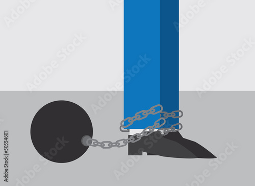Business Worker with ball and chain attached to foot