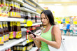 woman buys sunflower soy sauce