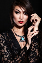 sexy stylish brunette model with bright makeup, with red lips