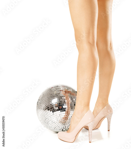 Woman legs and disco ball