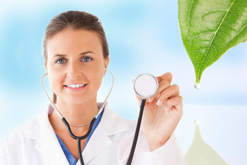 Doctor holding up stethoscope for natural treatment