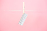 Contraceptive pill blister pack hanging from line