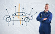 Mechanic standing proudly in front of a diagram car on backgroun