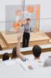 Teacher in front of futuristic interface university college stud