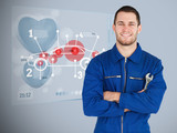 Portrait of a young mechanic next to futuristic interface