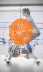 Woman riding exercise bike with futuristic interface showing los
