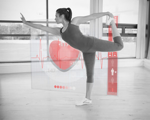 Woman in yoga pose with interface showing her heartbeat